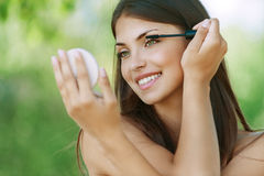 Dark-haired smiling young woman Royalty Free Stock Images