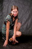 Dark haired tall girl sitting on knees Royalty Free Stock Photography