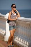 Dark haired teen girl in sunglasses Stock Photo