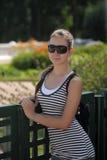 Dark haired teen girl in sunglasses Stock Photography