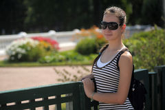 Dark haired teen girl in sunglasses Stock Images