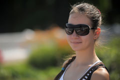 Dark haired teen girl in sunglasses Royalty Free Stock Photos