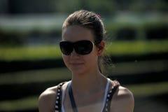 Dark haired teen girl in sunglasses Stock Images