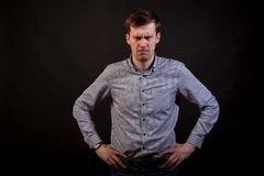 A dark haired white angry man royalty free stock photos