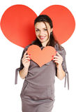 Dark-haired woman. Beautiful dark-haired woman with a heart in his hands stock image