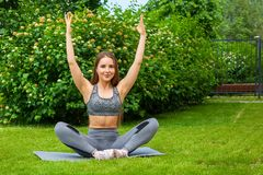 Woman doing exercises in the park royalty free stock photo