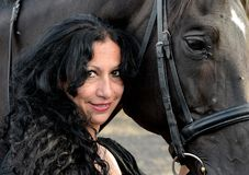 Woman with brown horse Royalty Free Stock Photography