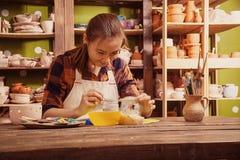 Woman potter paint Stock Images