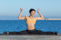 Dark-haired woman practicing gymnastic twine Royalty Free Stock Image