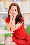 Dark-haired woman in red dress Royalty Free Stock Photos
