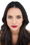Dark haired woman with red lips Royalty Free Stock Images
