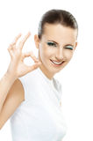 Dark-haired woman shows sign OK Stock Photo