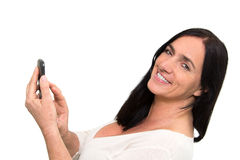 Dark haired woman using a Smartphone Stock Photography