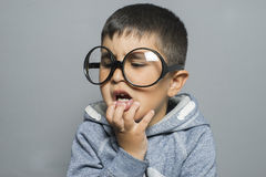 Dark-haired young student with big glasses thinking gesture Stock Photo