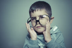 Dark-haired young student with big glasses thinking gesture Royalty Free Stock Photo