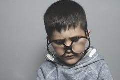 Dark-haired young student with big glasses thinking gesture Stock Photography
