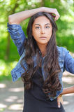Dark-haired young woman in denim Royalty Free Stock Photography