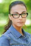 Dark-haired young woman in denim Stock Image