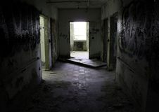 Dark hallway in an abandoned hospital. / asylum. Patient rooms and windows Royalty Free Stock Images