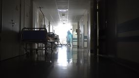 Dark hallway with the beds in the hospital. Dark long hallway with the beds in the hospital stock video