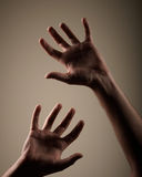 Dark hands Stock Photo
