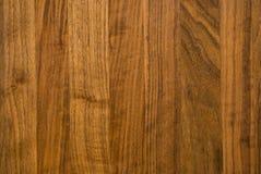 Dark hard wood background. A dark hardwood textured background. Rich wood grain details Stock Photo