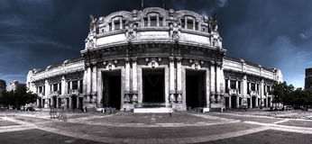 Dark HDR panorama photo of the Central railway station in Milan, Italy. Royalty Free Stock Image