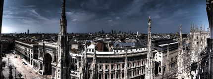 Dark HDR panorama photo of marble statues of Cathedral Duomo di Milano ,Milan cityscape and Galleria Vittorio Emanuele II. Dark HDR photo of the white marble royalty free stock photography