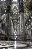 Dark HDR photo Interior of the famous Cathedral Duomo di Milano on piazza in Milan Stock Images