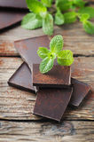 Dark healthy chocolate with green mint Stock Photos