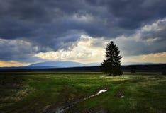 Dark heavy clouds above the autumn landscape. Nature background dark heavy clouds above the autumn landscape stock image