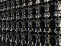 Dark heavy metal wall of skulls Royalty Free Stock Photo