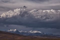 Dark heavy clouds over Andes mountains stock photo