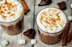 Dark hot chocolate with whipped cream and salted caramel sauce o stock photo