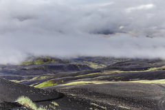 Dark Iceland Landscape With Green Moss And Black Road, Iceland Royalty Free Stock Photos