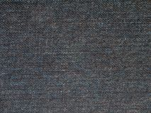 Dark indigo washed denim. Fabric texture swatch Royalty Free Stock Photos