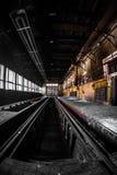 Dark industrial interior of a building Stock Photos