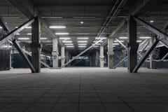 Dark industrial interior at underground. Facility angle shot Stock Photos