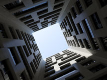 Dark inner courtyard tall modern office tower 3d Royalty Free Stock Photo