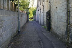 Dark Innercity Alleyway. View of a Long Dark Innercity Alleyway Stock Photography