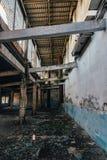 Dark interior of empty abandoned factory royalty free stock photos