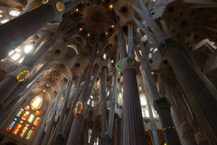 Dark interior of La Sagrada Familia Stock Images