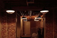 Dark interior with lamps. Distillery Gallery, Toronto. Dark interior with lamps with metal shades Royalty Free Stock Photo