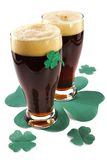 Dark Irish beer for St Patick's Day. On napkins stylized under clover leaf Stock Image