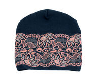Dark knitted hat with a pink pattern. Royalty Free Stock Photography