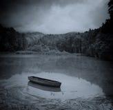 Dark Lake and Boat Royalty Free Stock Photo