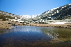 Dark lake at gredos mountains Stock Photos
