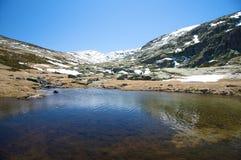 Dark lake at gredos mountains Stock Photos