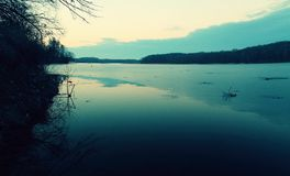 Dark lake. Water surface of lake in the evening Stock Photo