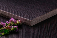 Dark Laminated particleboards with clover flowers. Laminated particleboard (chipboard) is used in the furniture industry. Chipboard, which applied decorative stock photos